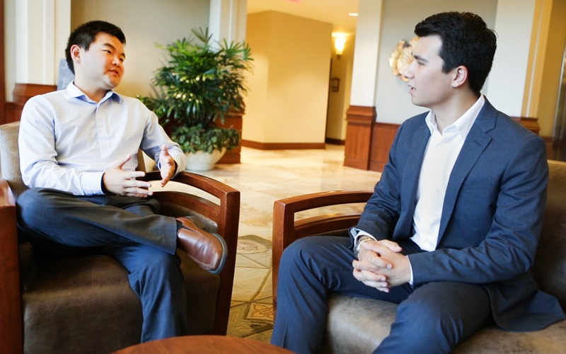 A student talks with a company representative during a job shadow