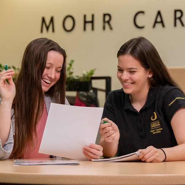 A peer advisor helps another student in the Mohr Career Services suite