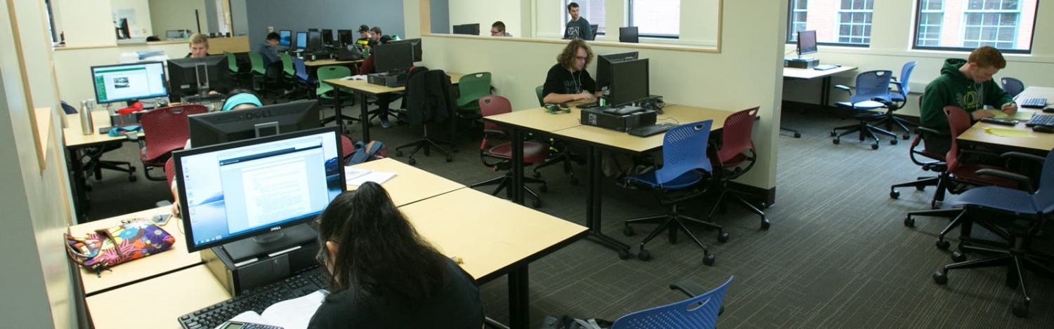 Students work at computers in McKay Technology lab in Lillis Business Complex