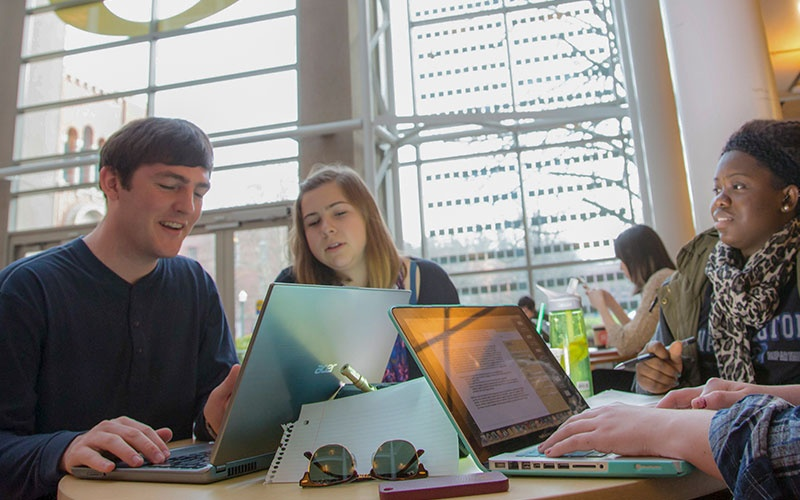Students work together in the Lillis atrium