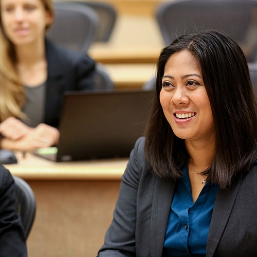 Oregon MBA student in class smiling and enjoying the experience