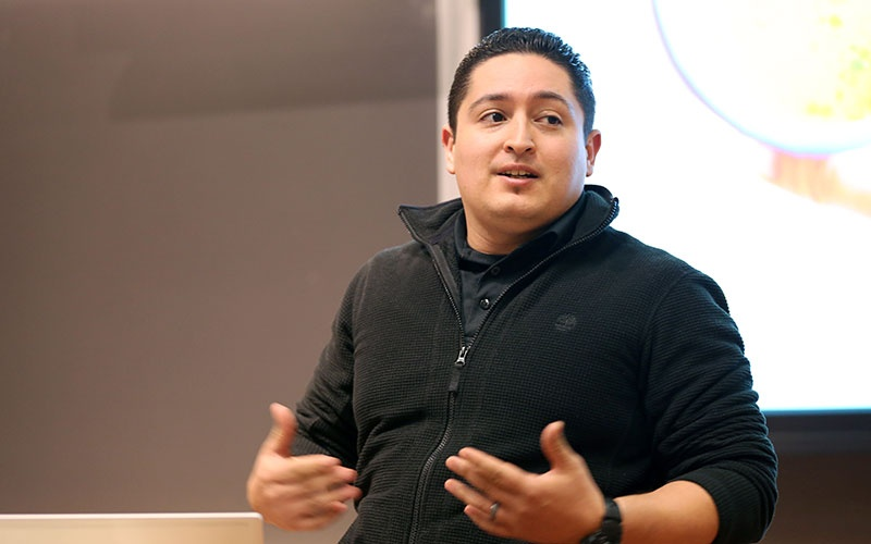 Oregon MBA student presents his idea in class