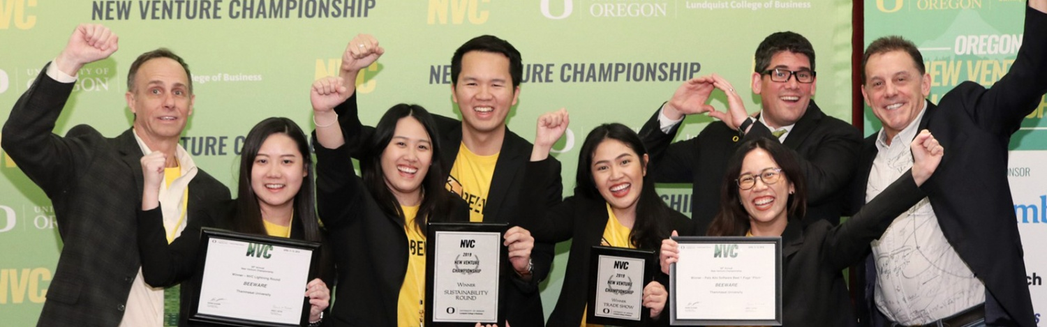 NVC sustainability round winners hold up their awards