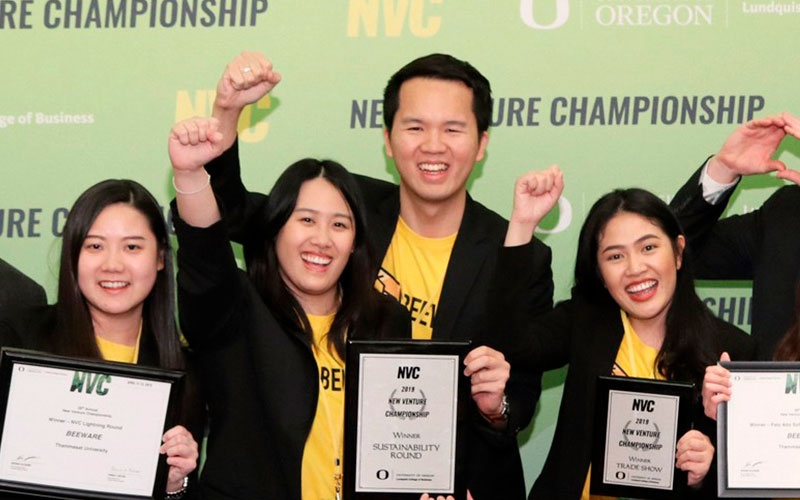 An NVC team celebrates their award