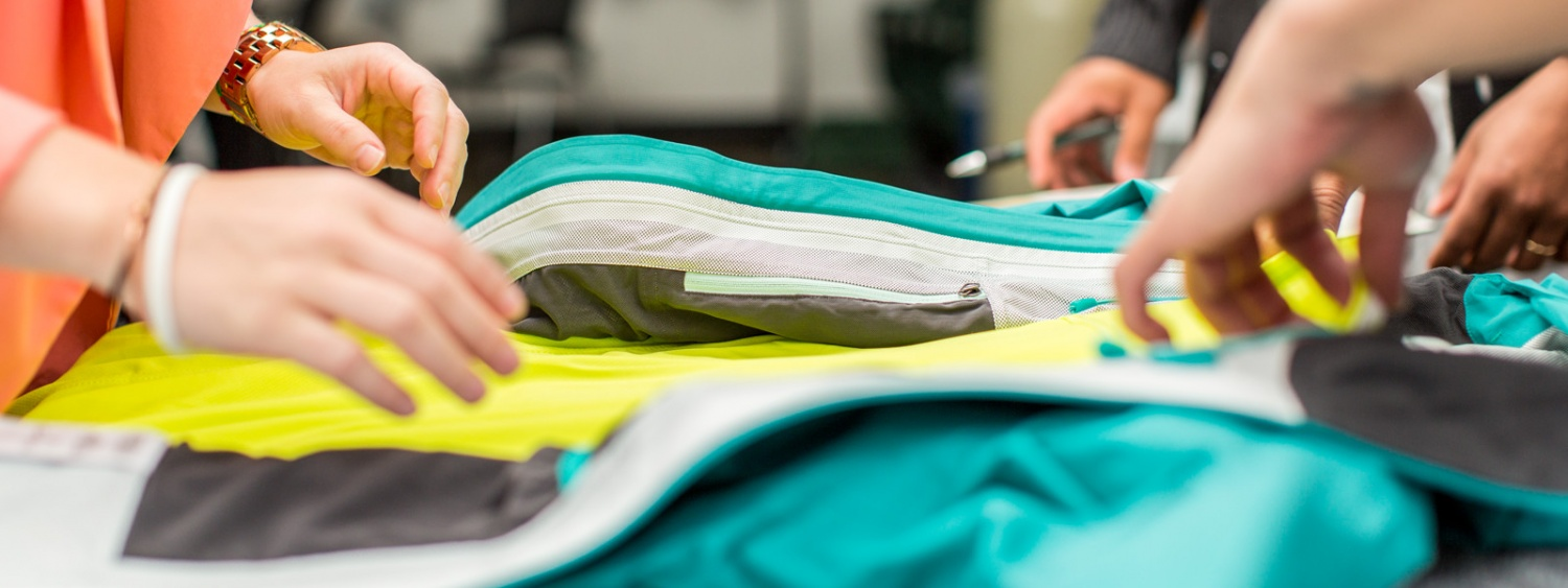 Close-up on rain jacket being designed by SPM students in the innovation lab