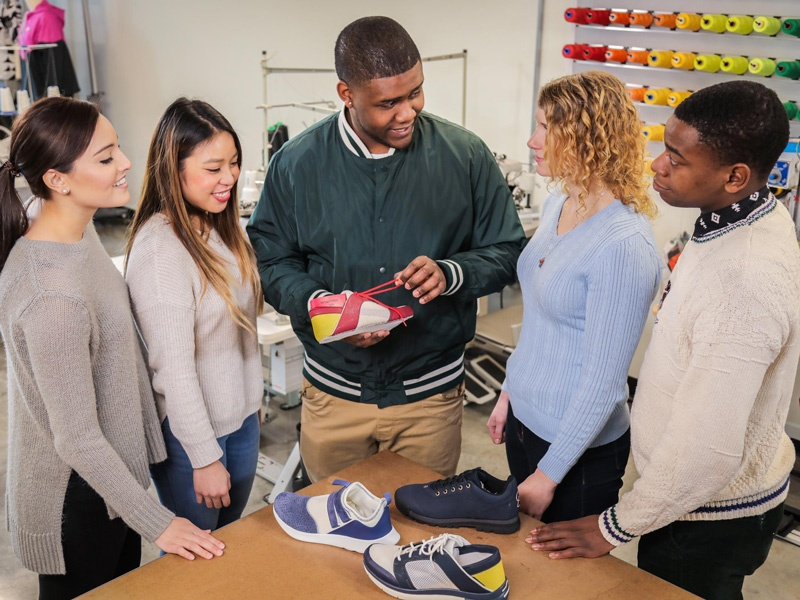 Five SPM students discuss shoe making while in the program's innovation lab in Portland