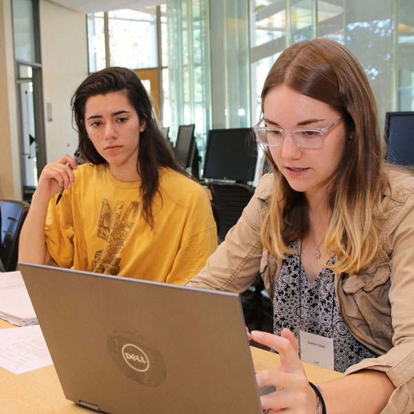 Students study with each other in the Braddock Tutoring Center