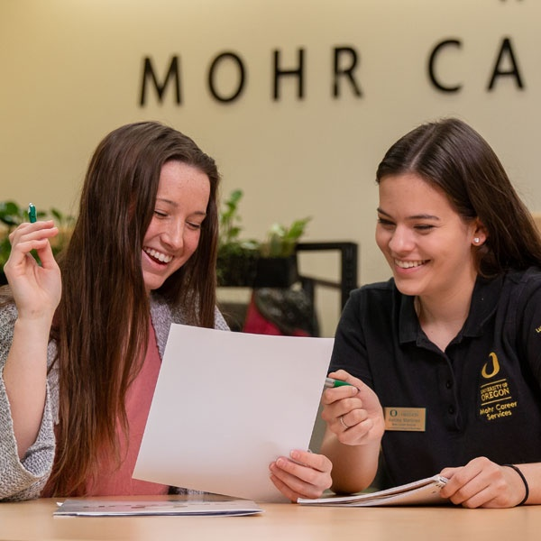 A career services staff member advises a student