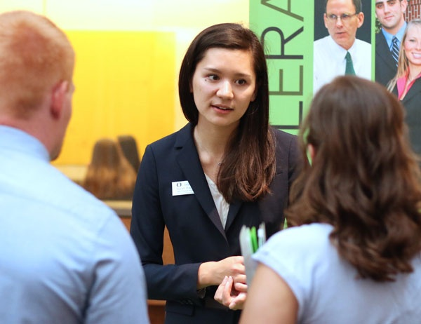 An accounting firm representative speaks to students