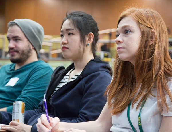 Students listen during a panel presentation