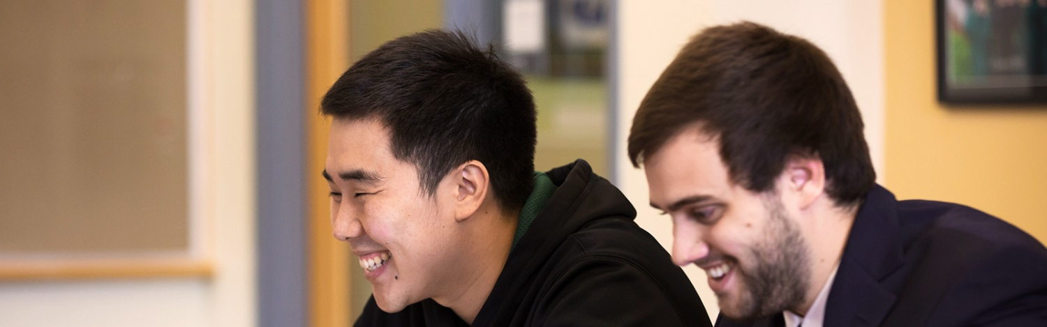 Two students smiling together