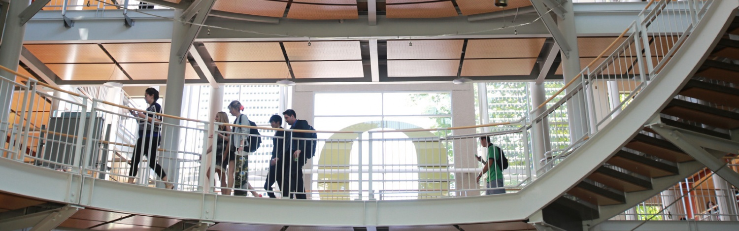 Students walk to class through the Lillis atrium