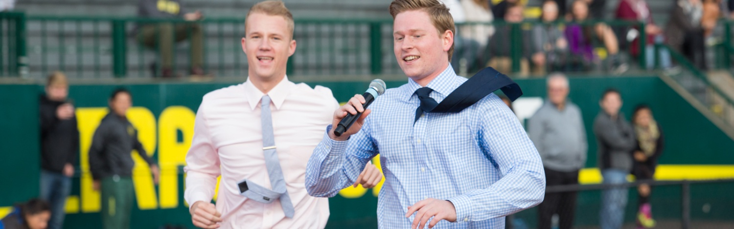 Two students share their business plan while on the track at Hayward Field