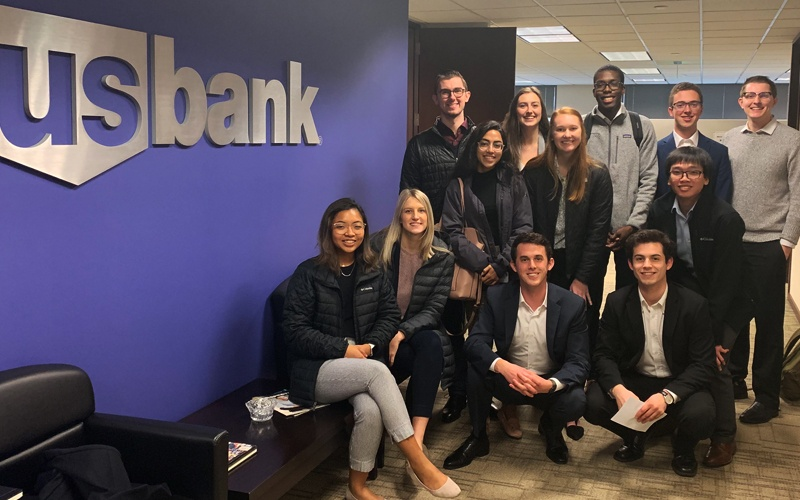 OCG members pose for a group photo in the offices of US Bank