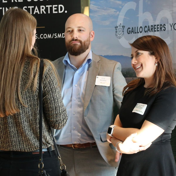 Recruiters speak with a student