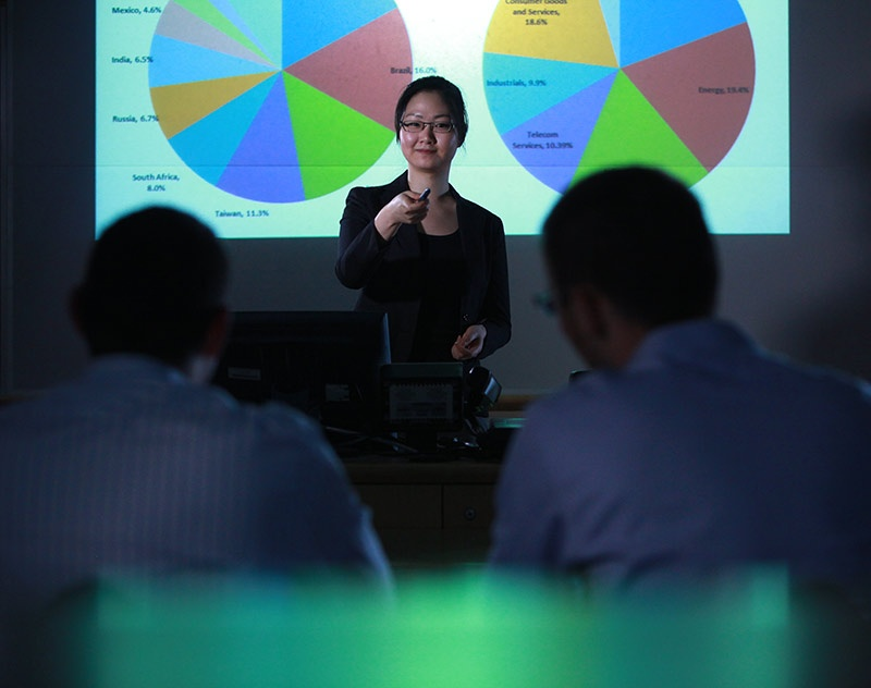 A student presents her research to an audience