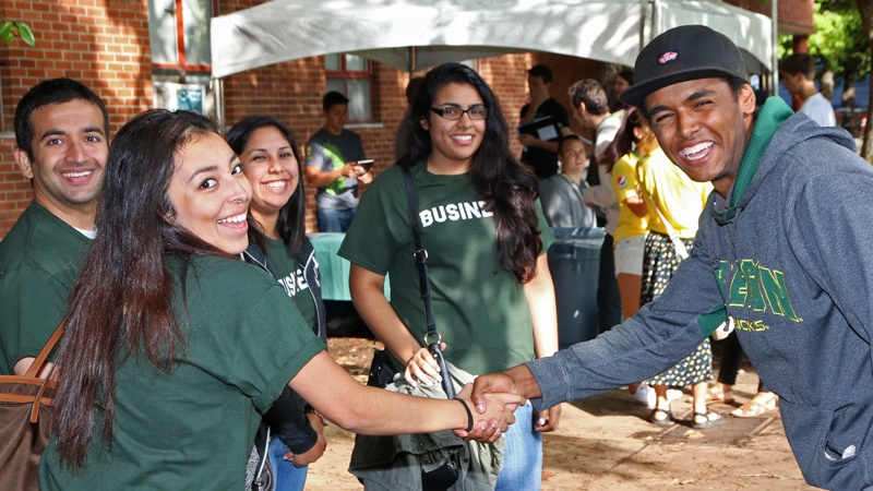 Students shake hands on move-in day