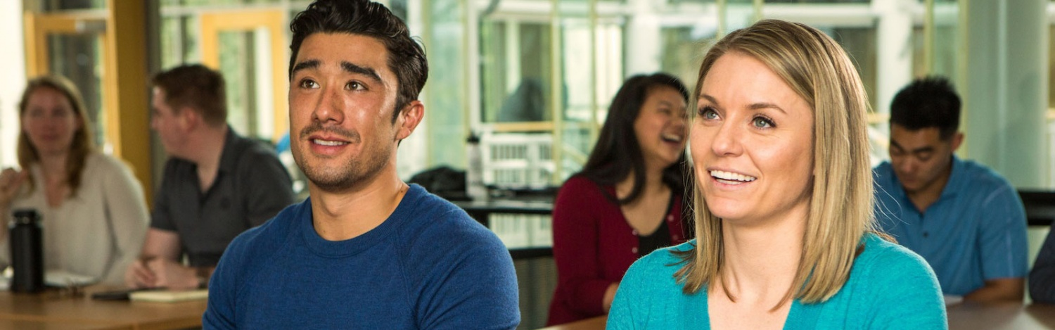Two students listen in class