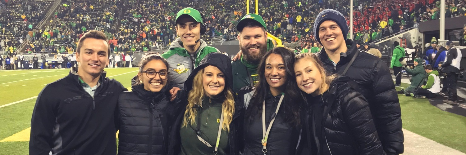 Warsaw Sports Business Club members pose for a group photo on the field at Autzen stadium