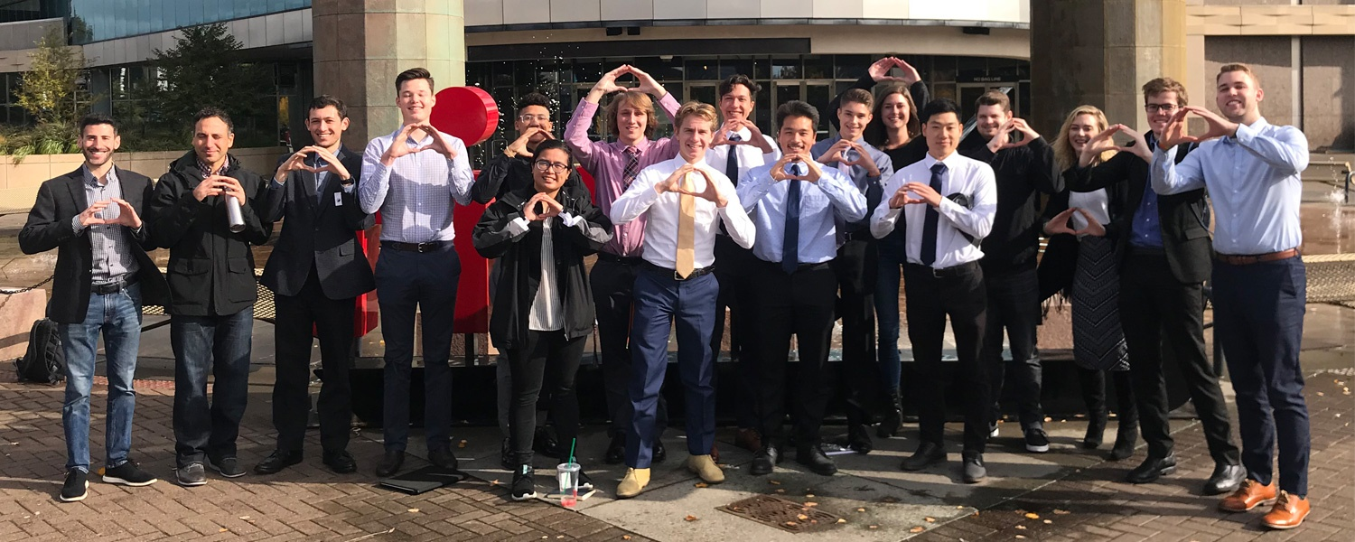 Warsaw Sports Business Club members pose for a group photo outside the Moda Center