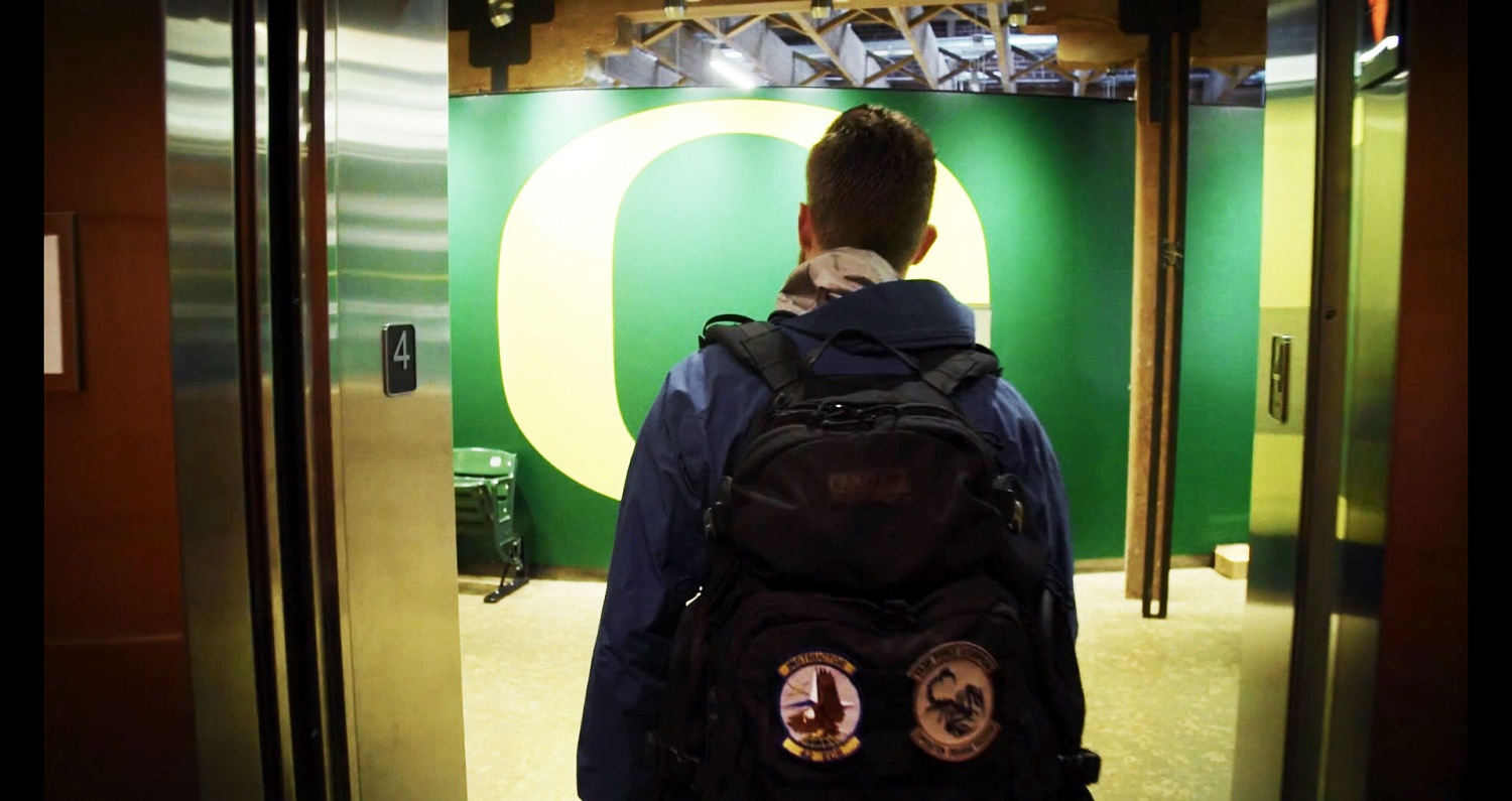 Student walking into UO athletic center