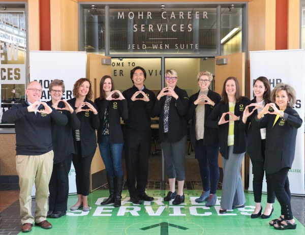 Mohr Career Services staff throw the O in a group photo
