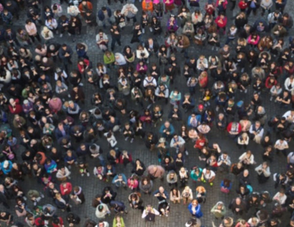 Drone photo looking down at a crowd assembled below