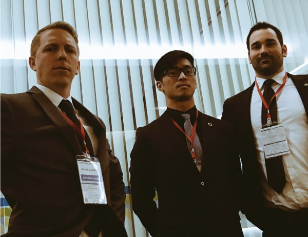 Three Oregon MBA students from Feros looking confident after pitching their startup in Thailand