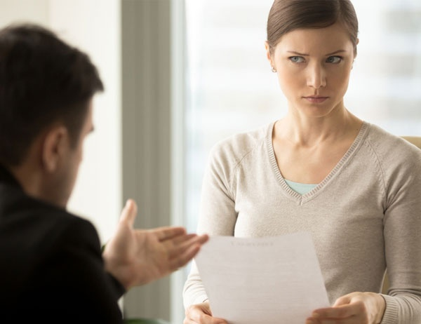 A woman gives the man speaking to her a severe side-eye