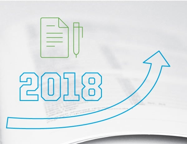 Graphic of upward-pointing arrow with 2018 against background of paperwork