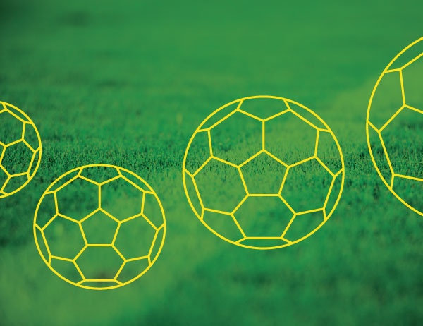 Graphic of soccer balls against background of grass