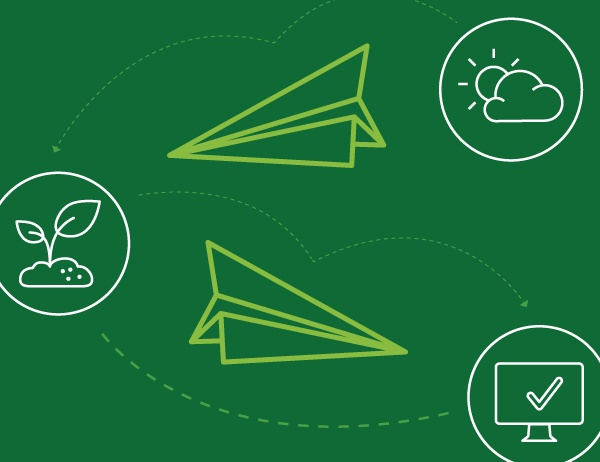 Icons representing sustainability and paper airplanes against a green background