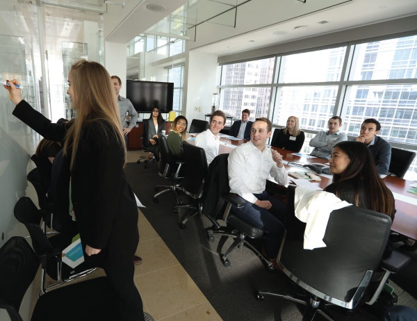 Honors students attend a meeting in the office of a San Francisco company