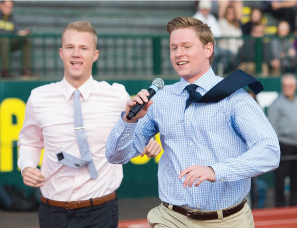 Two students pitch their business while running a lap at Hawyward Field