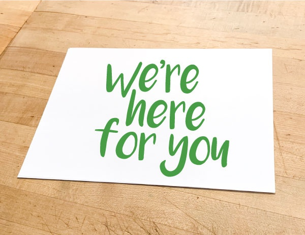 You Got This written on paper scrap in green against wood background