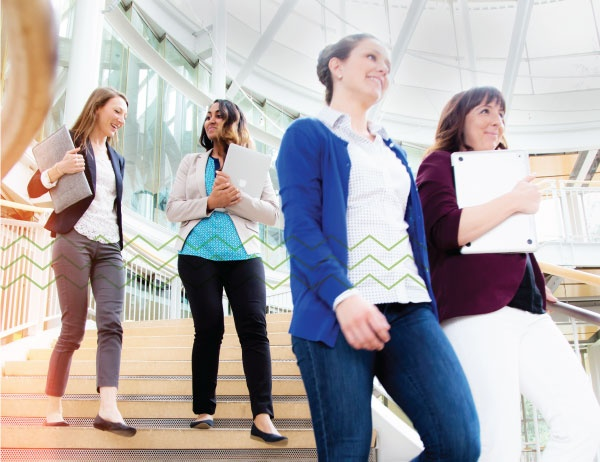 MBA students descend the stairs in the Lillis Business Complex