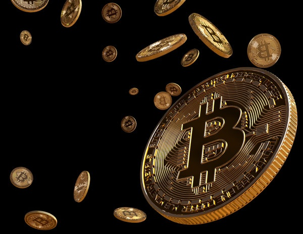 Image of gold bitcoins falling against black background