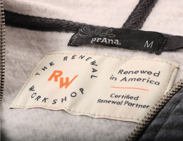 A tag applied to recycled clothing created by The Renewal Workshop
