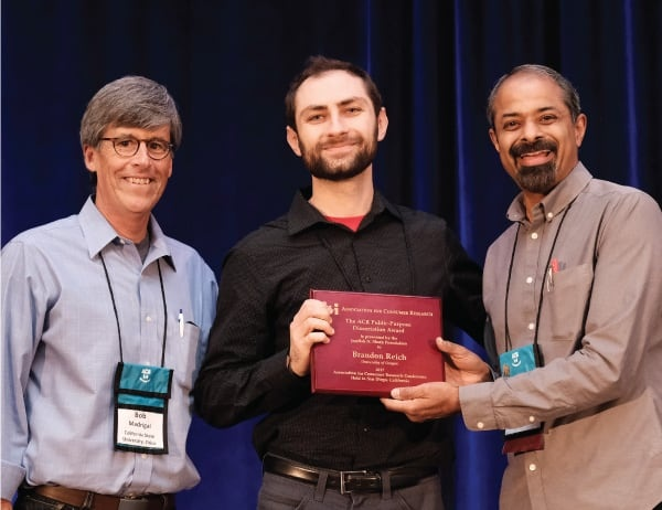Brandon Reich receives his dissertation award