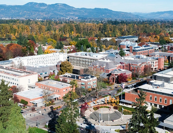 Aerial photo of the UO campus with mountains in the background