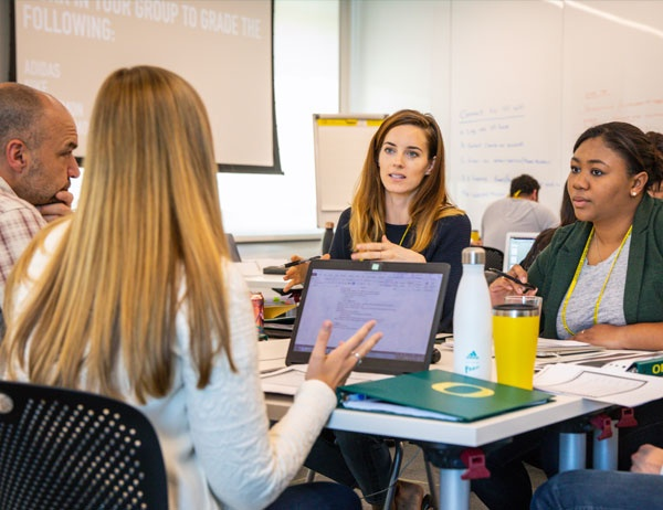 Students discuss their work during a Sports Product Management workshop