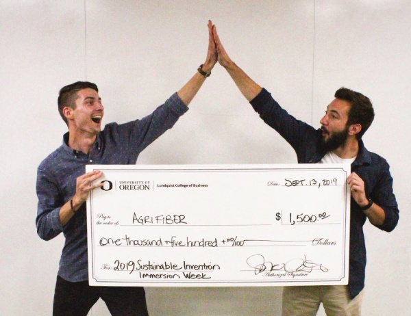Agrifiber founders high five over their reward check
