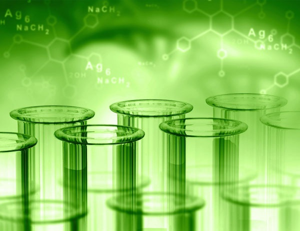 Beakers against a green backdrop with chemical formulas