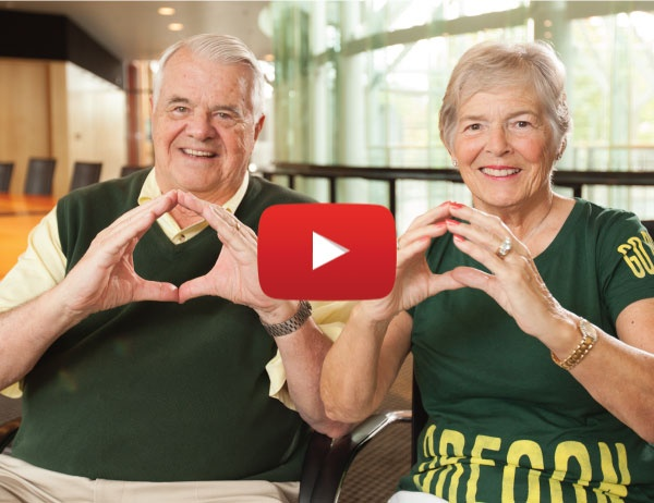 Screen capture from video announcing the gift showing Gerry and Marilyn Cameron throwing the O