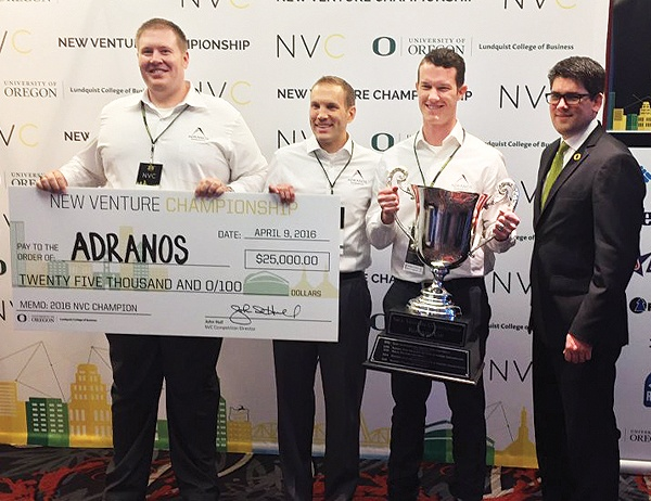 Photo of winning team Adranos Energetics with giant check