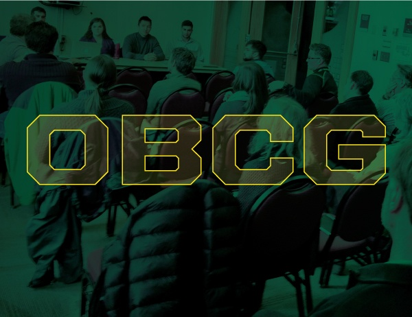 OBCG lettering in foreground of image of conference