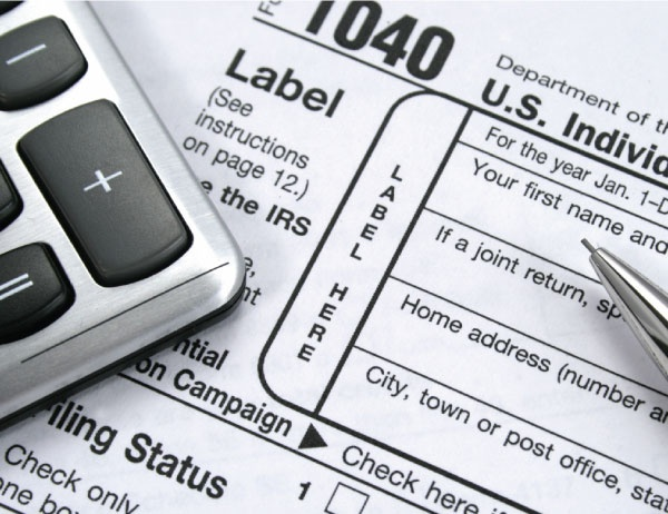 Image of taxes and a calculator