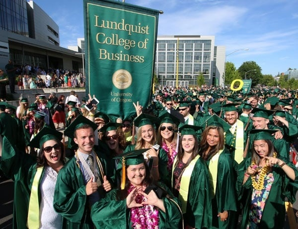 Graduates gather outside Matthew Knight Arena