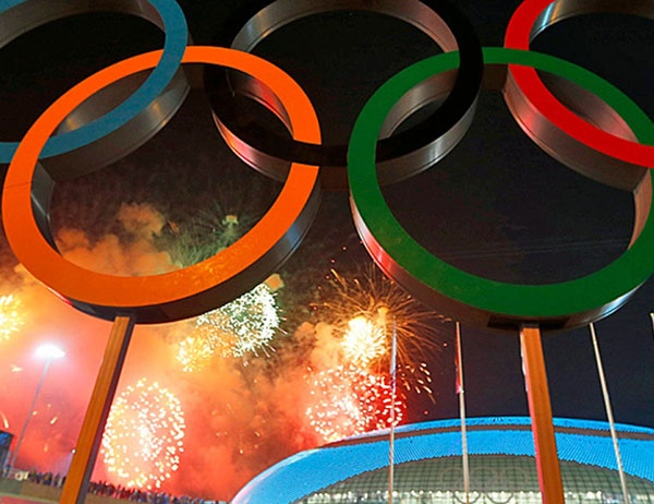 Olympic rings against a backdrop of fireworks