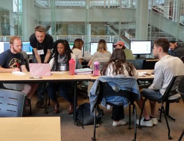 Accounting students helping others prepare their taxes